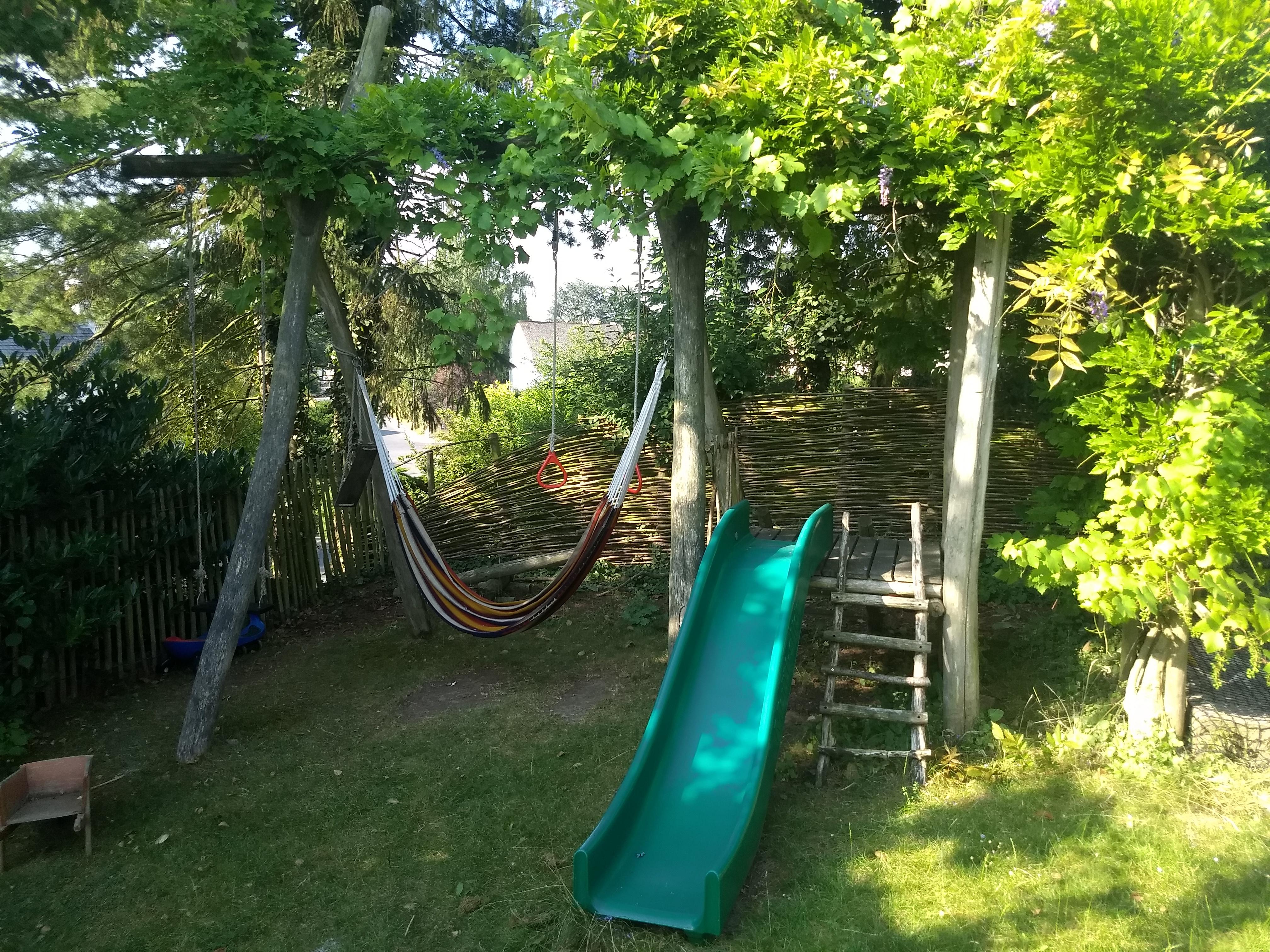 Swing, slide and sandpit